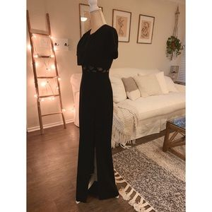 Black BCBG Maxazria gown with slit and lace under